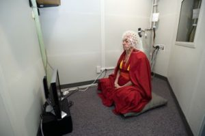 Wearing a 128-channel geodesic sensor net, Buddhist monk Matthieu Ricard sits in a soundproof room and prepares for an electroencephalography (EEG) test at the EEG facility in the Waisman Center at the University of Wisconsin-Madison on June 5, 2008. Ricard is a longtime participant in an ongoing research study led by Richard J. Davidson that monitors a subject's brain waves during various forms of meditation including compassion meditation. Davidson is director of the Waisman Lab for Brain Imaging and Behavior (WLBIB) and the William James and Vilas Professor of Psychology and Psychiatry. ©UW-Madison University Communications 608/262-0067 Photo by: Jeff Miller Date: 06/08 File#: NIKON D3 digital frame 2810