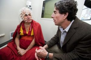Wearing a 128-channel geodesic sensor net, Buddhist monk Matthieu Ricard sits in a soundproof room and talks with Richard J. Davidson (right) before participating in an electroencephalography (EEG) test at the EEG facility in the Waisman Center at the University of Wisconsin-Madison on June 5, 2008. Ricard is a longtime participant in an ongoing research study led by Davidson that monitors a subject's brain waves during various forms of meditation including compassion meditation. Davidson is director of the Waisman Lab for Brain Imaging and Behavior (WLBIB) and the William James and Vilas Professor of Psychology and Psychiatry. ©UW-Madison University Communications 608/262-0067 Photo by: Jeff Miller Date: 06/08 File#: NIKON D3 digital frame 2849