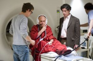 Technician Michael Anderle (left with eyeglasses) and co-principle investigators Richard J. Davidson (center wearing jacket) and Antoine Lutz (right) prepare Buddhist monk Matthieu Ricard for a functional magnetic resonance imaging (fMRI) test at the MRI facility in the Waisman Center at the University of Wisconsin-Madison on June 4, 2008. Ricard is a longtime participant in an ongoing research study led by Davidson that monitors a subject's brain activity and the impact of meditation on pain regulation. Davidson is director of the Waisman Lab for Brain Imaging and Behavior (WLBIB) and the William James and Vilas Professor of Psychology and Psychiatry. ©UW-Madison University Communications 608/262-0067 Photo by: Jeff Miller Date: 06/08 File#: NIKON D3 digital frame 2584
